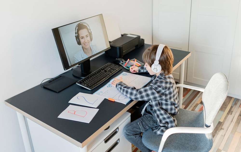 school boy taking online courses long shot - Student Experience - LRNG Academy - Shaping Boundless Generations - Online Tutoring | Online Learning | eLearning | Virtual School | Tutoring Service | Virtual Learning