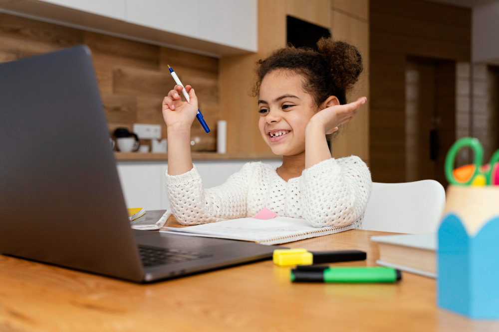 smiley little girl home during online school - Student Experience - LRNG Academy - Shaping Boundless Generations - Online Tutoring | Online Learning | eLearning | Virtual School | Tutoring Service | Virtual Learning